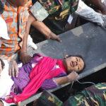 Bangladeshi rescuers retrieve garment wo