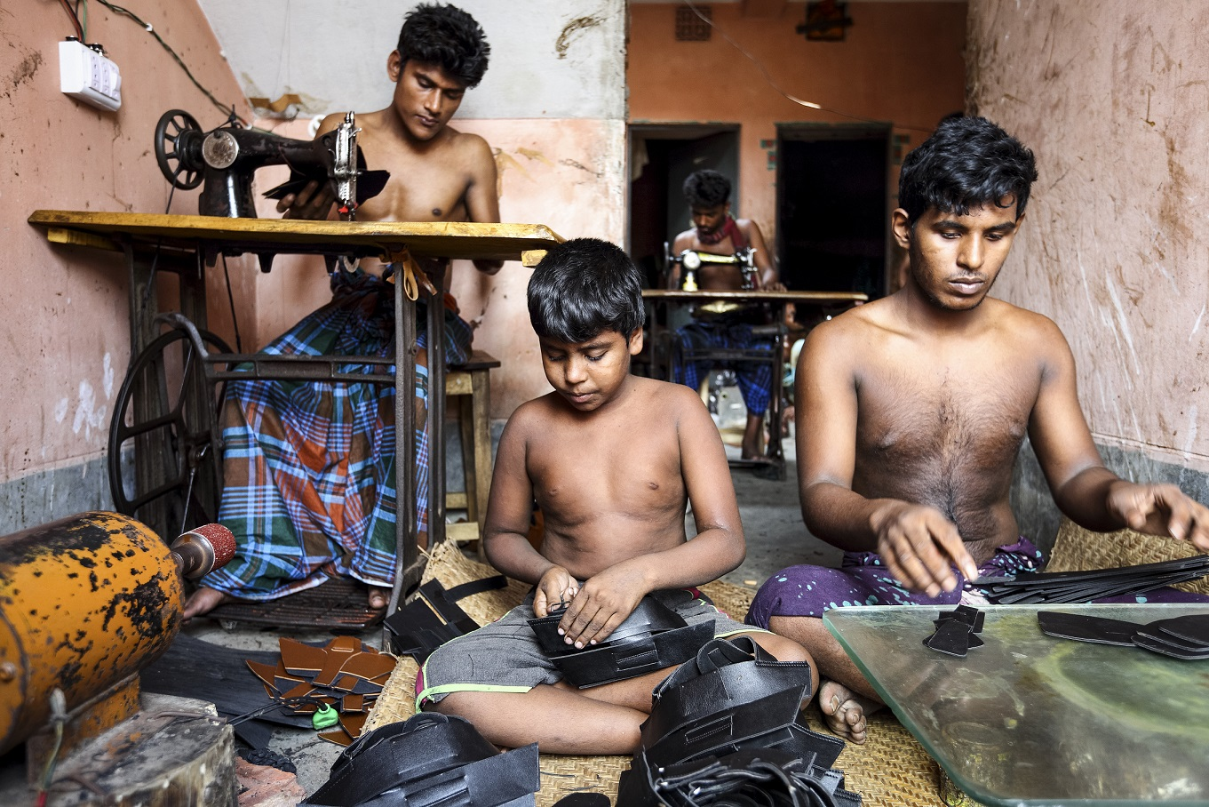 Case 24: Full name: Hasan, Age: 19, Unmarried, Experience: 5 years, Occupation: Cutting leather for making shoes, Location: Hazaribagh, 'I can hardly write my name. Without education I know I will never be able to do just any job. When getting a textile job nowadays people need education. So it is good for me that I learned this job. I worked in a tannery earlier, which is very dangerous for your health. So I started learning shoemaking. Right now I can only cut the leather according to the size and design. But with time I will learn the full process of shoemaking. My parents live in a village and I still cannot send them enough money to cover their needs. I can earn a maximum of 8000 taka a month ($100). I live in this room with my five other colleague shoemakers. It is very hard to sleep during summer nights without a fan in this overcrowded room. But I cannot spend more than this with the money I make on accommodation and food. My colleagues say there is no future in this job but I hold my faith tightly; things will become better with time.'